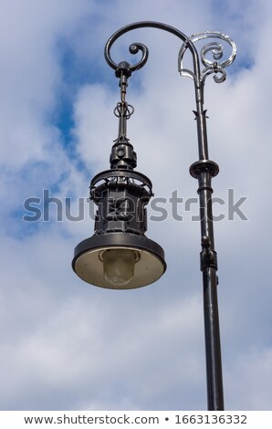 Art decoration streetlamps with cloudy sky Stock photo © Ansonstock