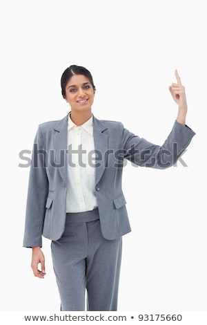Smiling saleswoman pointing upwards against a white background Stock photo © wavebreak_media