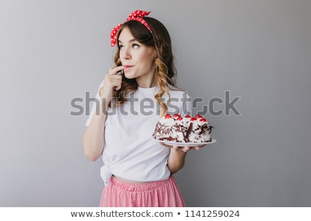 Attractive woman tasting a fruit dessert Stock photo © konradbak