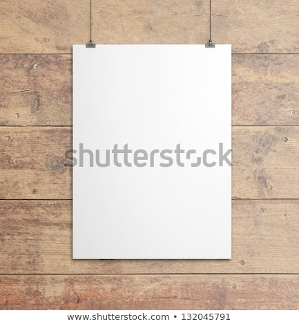 photo of the blank paper on wooden background stock photo © luckyraccoon