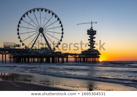 ferris wheel on sunset Stock photo © Witthaya