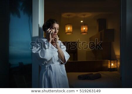 Vrouw telefoon ligstoel gelukkig mooie vrouw Stockfoto © deandrobot