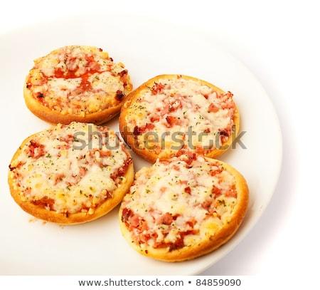 juicy mini pizza stock photo © badmanproduction