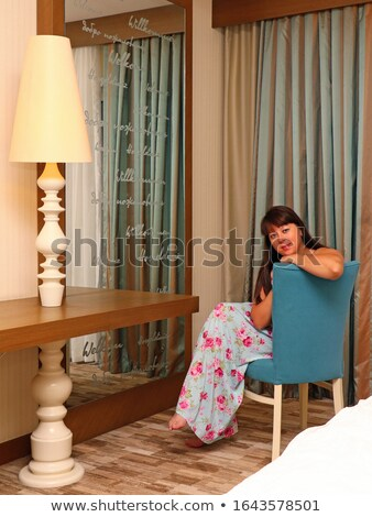 brunette in long dress near old-fashioned hotel Stock photo © ssuaphoto