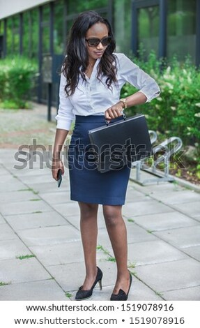 Female Executive With Briefcase Looking At Her Wristwatch Stock fotó © Francesco83
