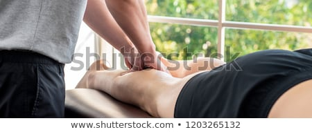 Physiotherapist giving hand massage to a patient in clinic Stock photo © wavebreak_media