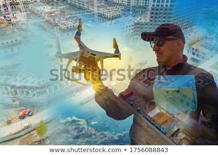 Man's Hand Operating The Quadrocopter Stock photo © AndreyPopov