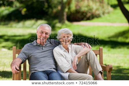 senior man and woman on old bench Stock photo © IS2