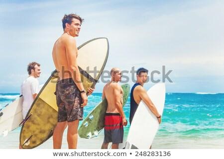 Cuatro personas agua libertad sonriendo surfista Foto stock © IS2