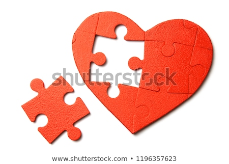 Couple Connecting Red Heart Puzzle Together Stock photo © AndreyPopov