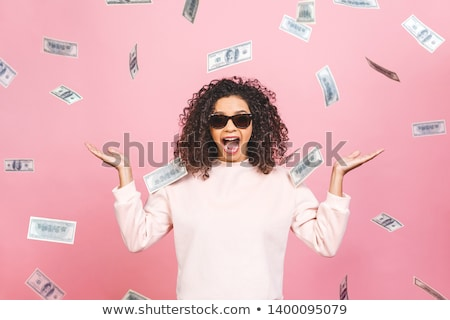 Young surprised woman with camera and cash Stock photo © Traimak
