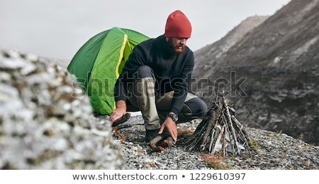 extreme camping in the winter mountain forest stock photo © kotenko