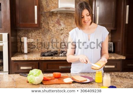 kobieta · śniadanie · piękna · młoda · kobieta · kuchnia · dziewczyna - zdjęcia stock © kzenon