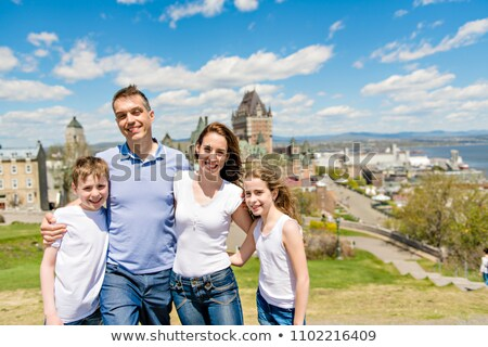 family in summer season in front of Chateau frontenac Quebec Stock photo © Lopolo
