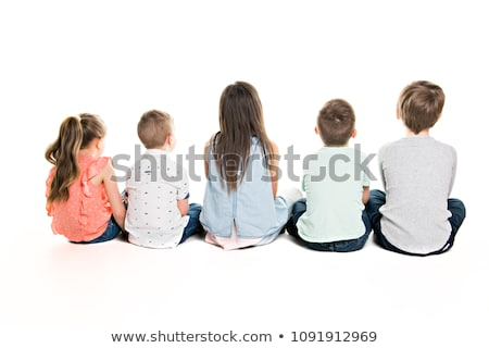 Back view of child group sitting on floor looking at wall Stock photo © Lopolo