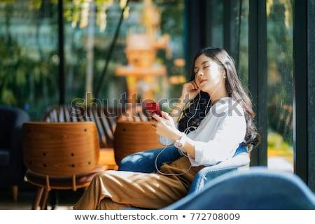 Smiling girl relaxing in cafe. Stock fotó © NeonShot