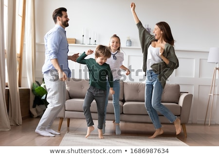 Excited daughter enjoying fathers music Stock photo © pressmaster