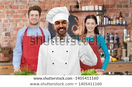 happy male indian chef showing ok at cooking class Stock photo © dolgachov