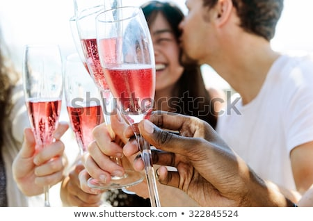 Happy friends celebrating special occasion together on beach at  Stock photo © dashapetrenko
