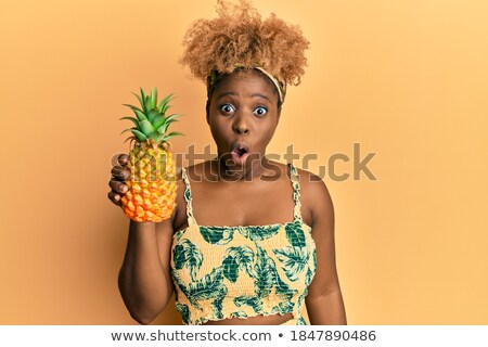 Surpreendente jovem africano mulher ananás Foto stock © deandrobot