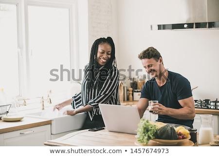 Femme souriante ménage blanche fond travail Homme Photo stock © wavebreak_media