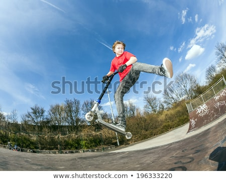 Fiú ugrik rámpa boldog fény bicikli Stock fotó © meinzahn