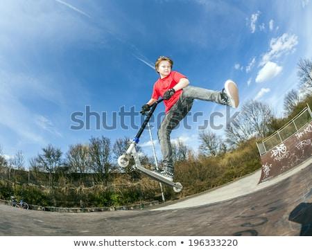 boy jumping over a ramp Stock photo © meinzahn