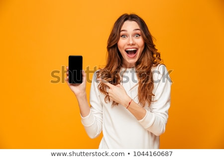 casual woman cheering while on the phone Stock photo © feedough