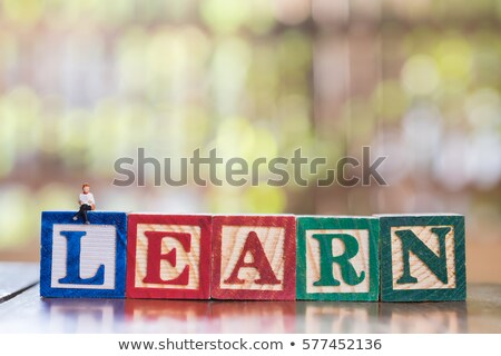 Book on Colored Wooden Childrens Alphabet Block. Stock photo © tashatuvango