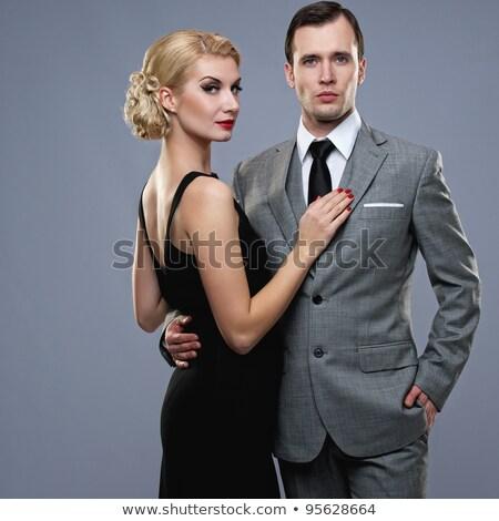 Well-dressed retro couple on grey background Stock photo © Nejron
