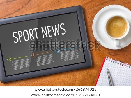 Stock photo: Tablet on a wooden desk - Sport News