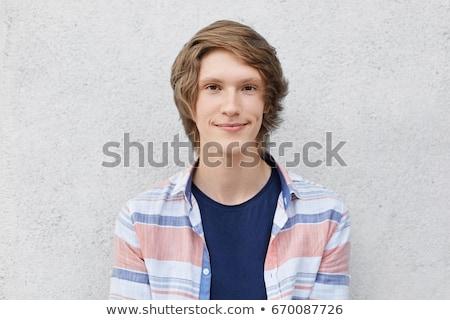 Közelkép férfi fiatalember portré fehér kéz Stock fotó © lunamarina