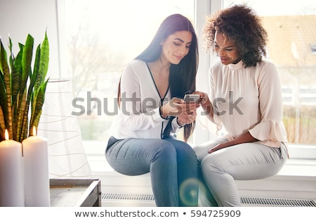 Two young woman checking a text message Stock photo © dash