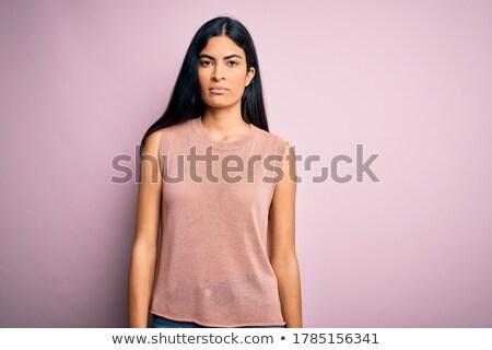 Colère jeune fille chandail permanent isolé Photo stock © deandrobot