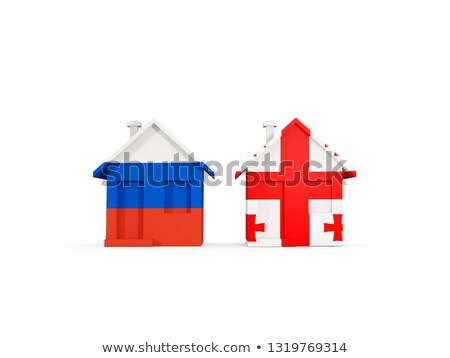 Two houses with flags of Russia and georgia Stock photo © MikhailMishchenko