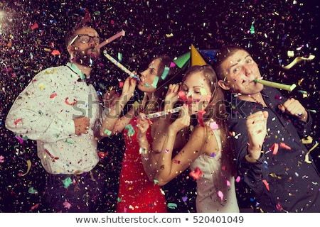 men and women in festive hats happy birthday stock photo © robuart