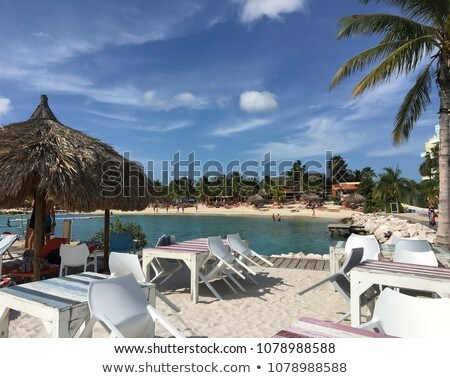 Lounge chairs on tranquil Grace Bay Beach Stock photo © jsnover