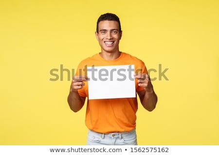 счастливым улыбаясь Hispanic мужчины оранжевый футболки Сток-фото © benzoix