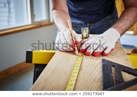 Laborer using measuring tape Stock photo © photography33
