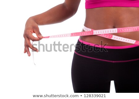 Ethnic woman measuring her waist with a tape measure Stock photo © wavebreak_media