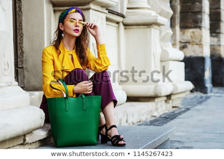 Beautiful  woman in violet blouse, Stock photo © Pilgrimego