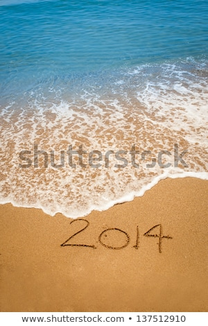 2014 on sand stock photo © pakhnyushchyy