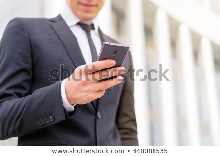 homem · de · negócios · leitura · sms · celular · bonito · feliz - foto stock © photography33