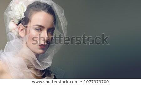 Donna moda abito bianco guardando ritratto Foto d'archivio © deandrobot