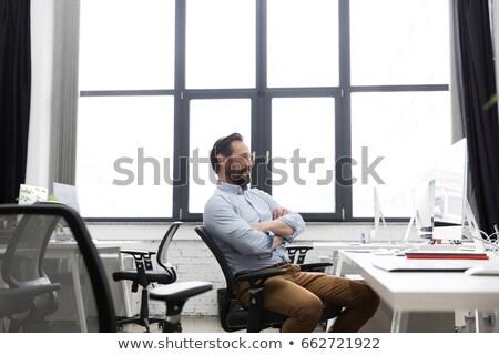 Olgun iş adamı oturma sandalye silah katlanmış Stok fotoğraf © deandrobot