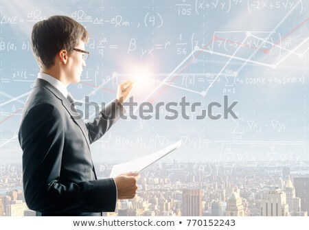 Businessman writing graph with sky background Stock photo © colematt