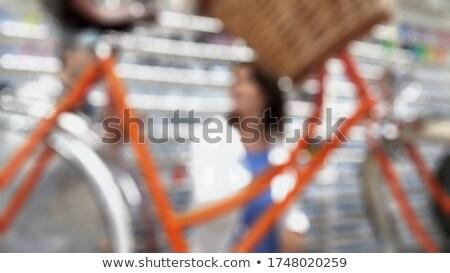 Bisiklet mekanik müşteri bakıyor bisiklet hizmet Stok fotoğraf © Kzenon