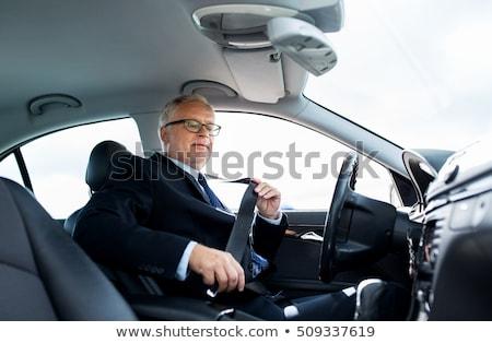 Idős üzletember autó ülés öv szállítás Stock fotó © dolgachov