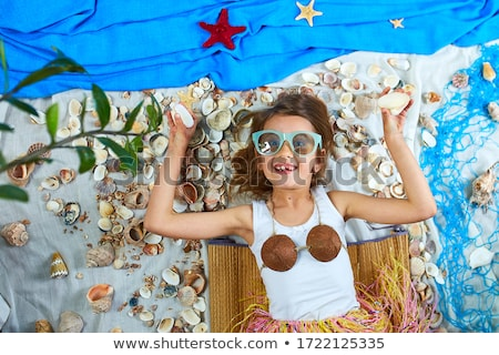 Little girl imitates Havaii vacation at home quarantine. Stock photo © Illia