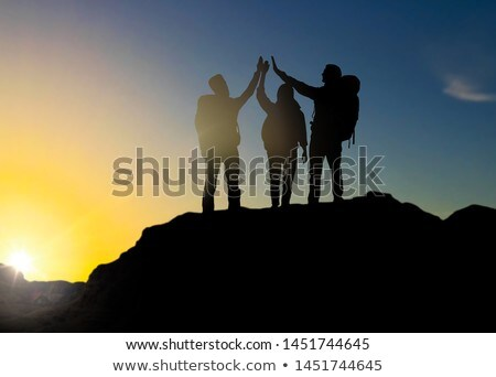 travellers making high five over sunset Stock photo © dolgachov